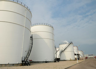 Storage tanks containing dangerous chemicals require multiple levels of instrumentation, controllers and software that can monitor the contents of a vessel and provide an alarm in the event of a leak or overfill event.